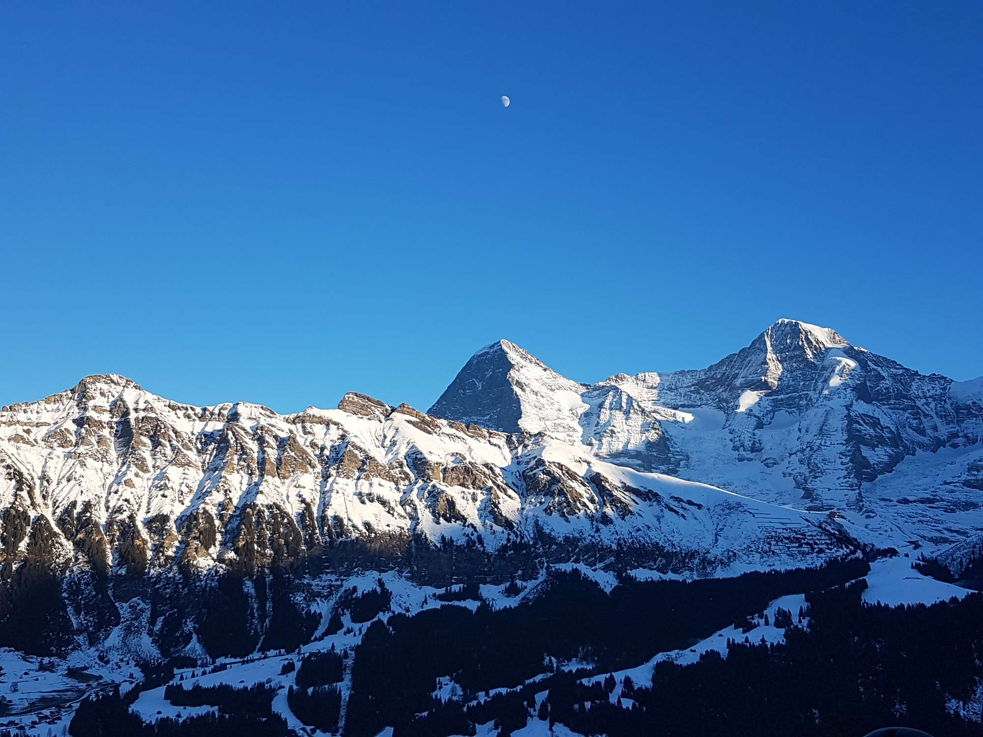 View of the Moon above the Eiger
