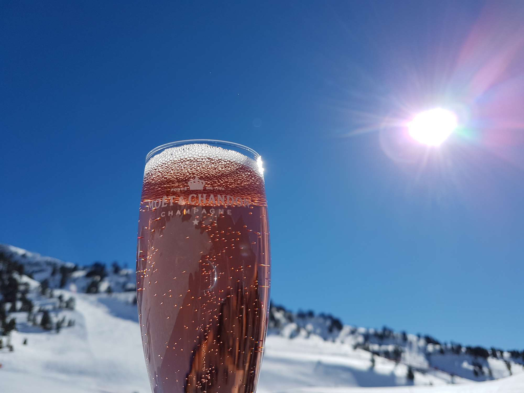 Drinking pink champagne at the Moet bar in Baqueira